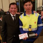 Mr Poh presenting the NTUC vouchers to Safe Driver Award Winner Heng Chee Nguan